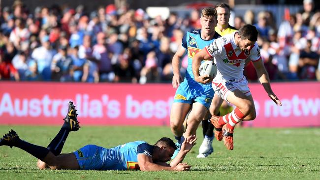 TOOWOOMBA, AUSTRALIA — MARCH 25: Ben Hunt of the Dragons breaks through the defence during the round three NRL match between the Gold Coast Titans and the St George Illawarra Dragons at Clive Berghofer Stadium on March 25, 2018 in Toowoomba, Australia. (Photo by Bradley Kanaris/Getty Images)