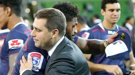 Rebels coach David Wessels gives Amanaki Mafi a hug after beating the Brumbies.