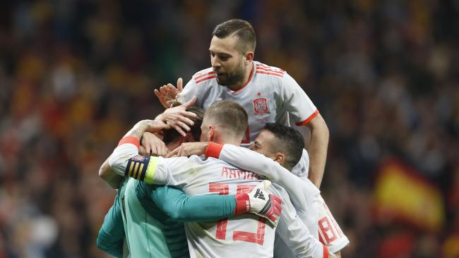 Spain players celebrate scoring 6-1 during the international friendly soccer match between Spain and Argentina