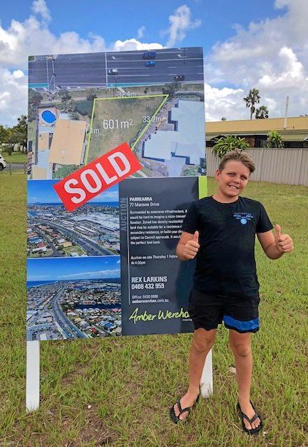Hudson Horne celebrates the sale of a property.