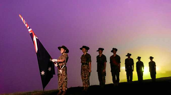 LEST WE FORGET: Younger generations at an Anzac Day dawn service.