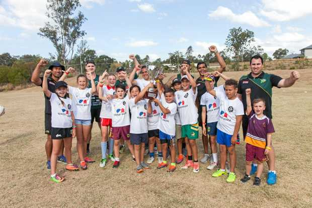 RETURNING: Ipswich Jets CEO Jason Cubit (right) joins with players and excited kids enjoying previous clinics at Ripley.