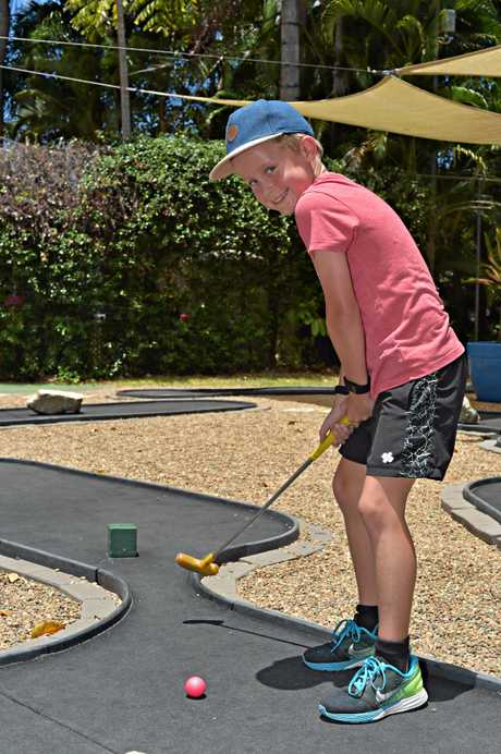 Jack Schultz plays mini golf at Bellingham Maze.