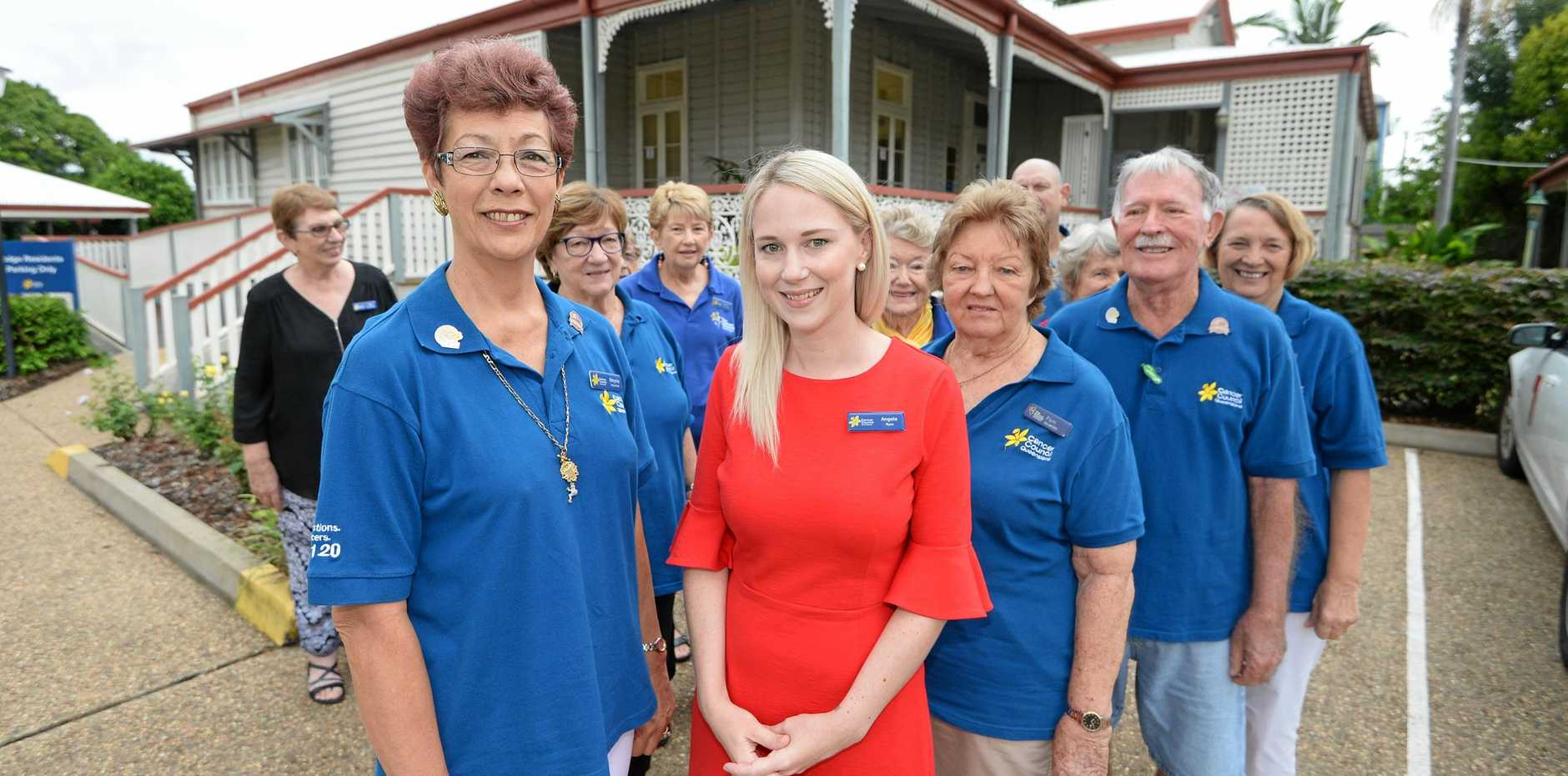 MILESTONE: Moyna Richarson with Angela Ryan from Cancer Council Queensland with volunteers at the Rockhampton lodge which celebrates 25 years of service.