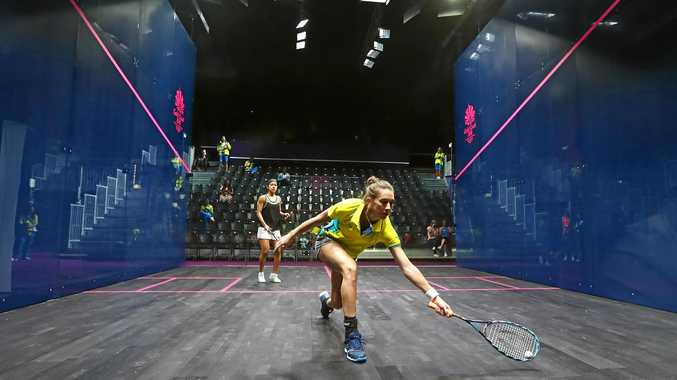 TIME ON COURT: Australian Donna Urquhart gets in some practice with number one seed Nicol David of Malaysia during the Squash Sports Showcase at Oxenford Studios.