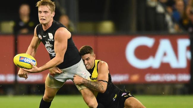 Jack Graham illustrates his desperation and tackling prowess, hauling down Carlton's Ciaran Byrne during Richmond's round one triumph at the MCG. Picture: Quinn Rooney/Getty