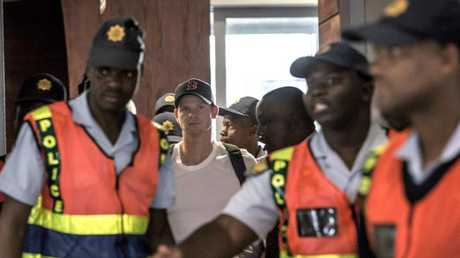 Security surrounds Steve Smith at Johannesburg Airport.