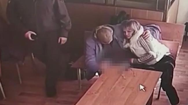 The lewd act brazenly performed in an open court room was captured on CCTV in Russia.