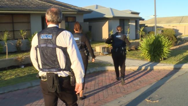 A supplied photograph of taskforce officers executing a search warrant at an undisclosed property in Western Australia. Picture: AAP.
