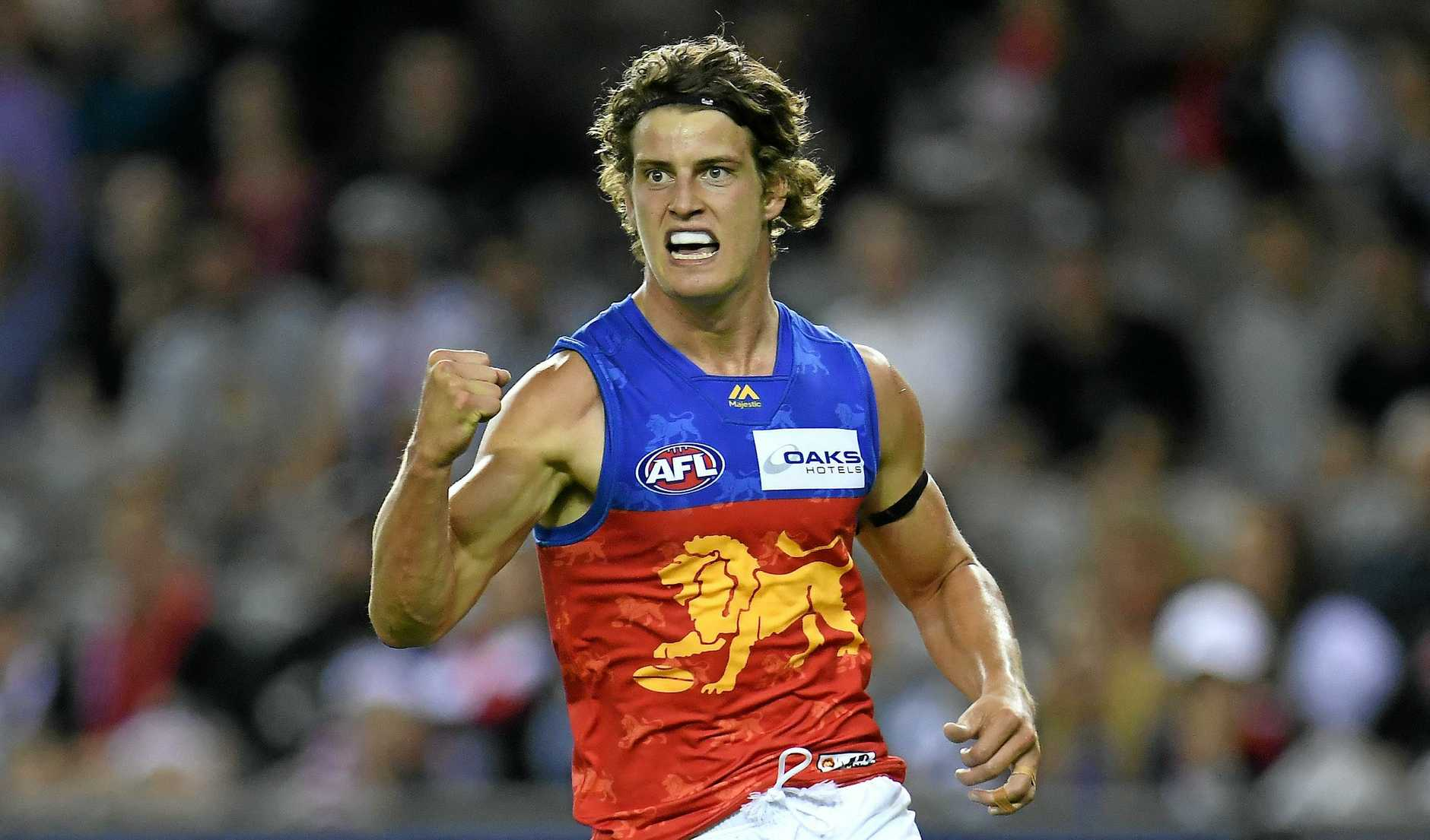 GREAT START: Jarrod Berry reacts after kicking a goal for the Lions in their season-opening clash with St Kilda.