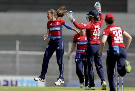 England's Tash Farrant, left, celebrates after taking Australia's Beth Mooney's wicket during the final of Women's Cricket T20 Triangular Series in Mumbai, India, Saturday, March. 31, 2018. (AP Photo/Rajanish Kakade)