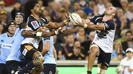The Brumbies' Henry Speight (left) and Lachie McCaffrey go for the ball on Saturday night.