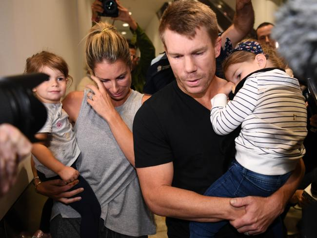 Candice wipes tears from her eyes as the family arrive at Sydney International Airport. Picture: David Moir/AAP
