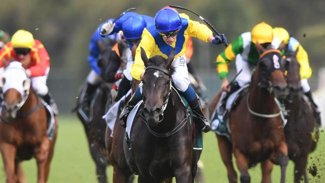 Hiyaam ridden by Michael Dee (centre) wins the Vinery Stud Stakes on Saturday. Picture: David Moir/aap
