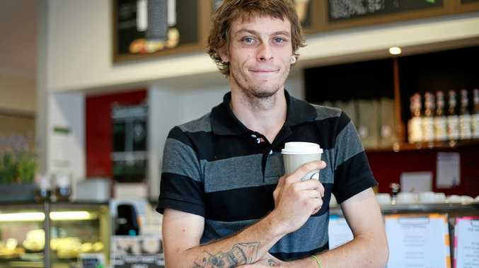 The Meeting Place Cafe in Goodna has a pay-it-forward service to help the homeless connect and have access to a warm cup of coffee. Blake Arnott pictured with a coffee someone has kindly paid for.