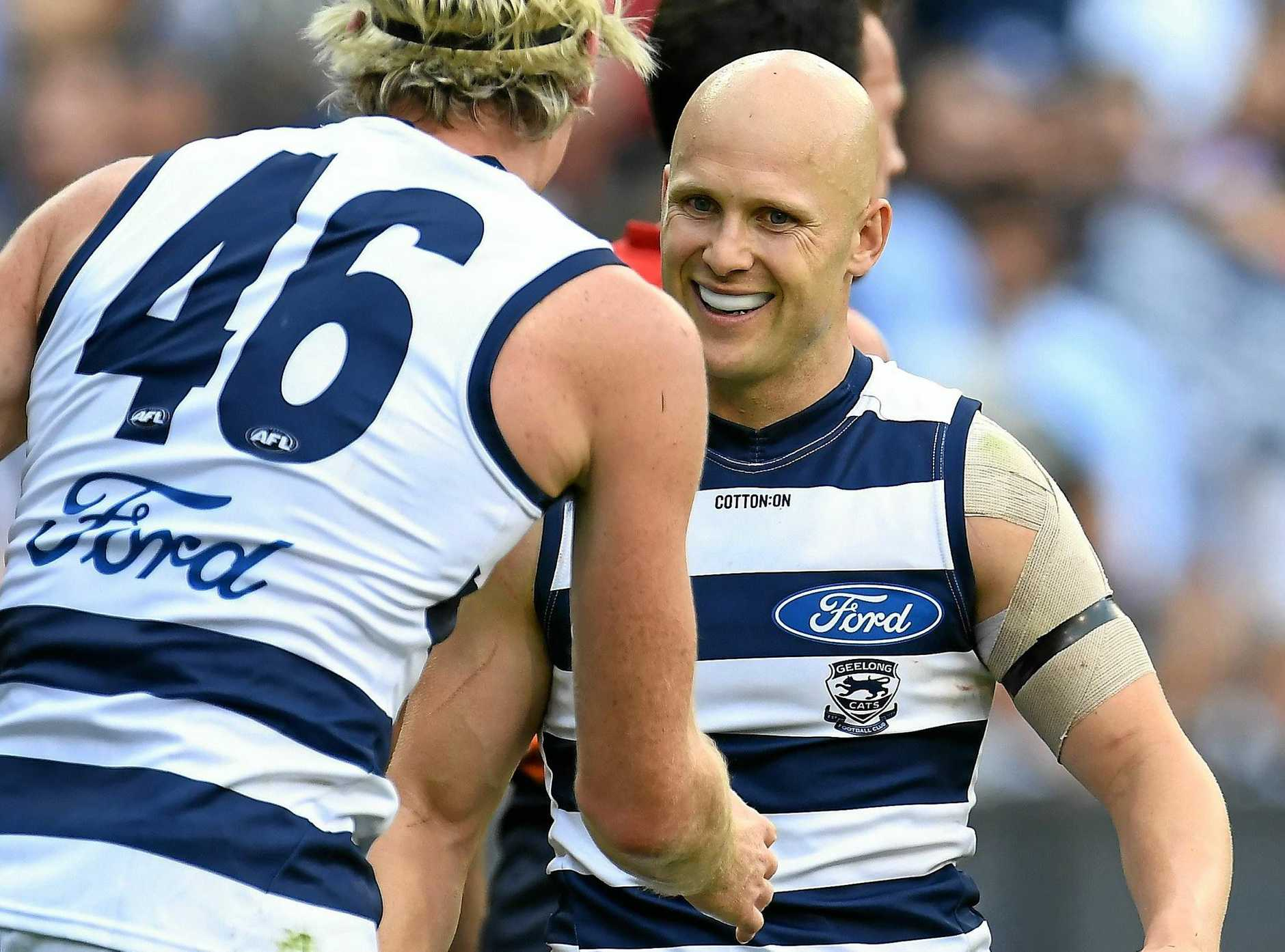 Mark Blicavs and Gary Ablett share some joy in the round one clash against Melbourne.