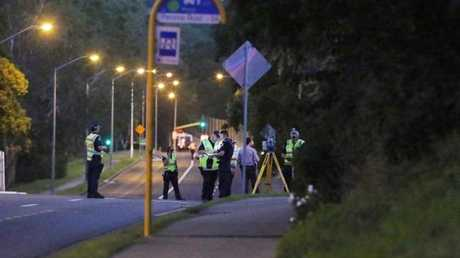 Police investigating the hit-and-run of a fellow officer in Tarragindi. Picture: AAP/ Ric Frearson
