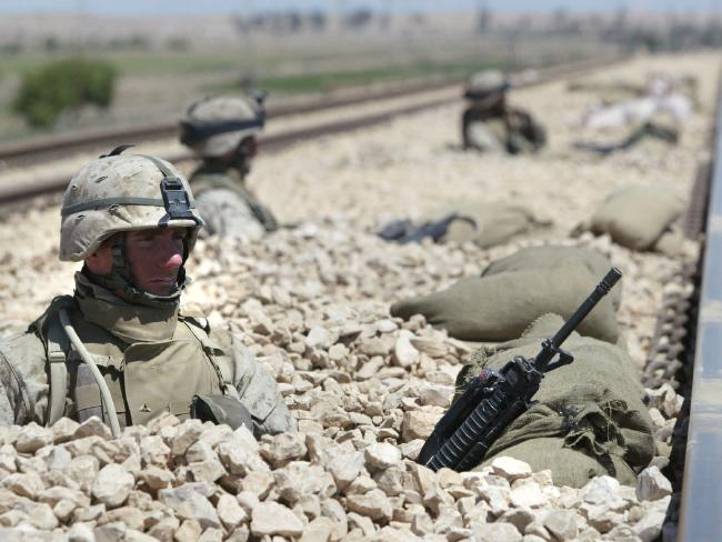 Matt was sent to Iraq three times. Pictured here are US Marines on railway line outside Fallujah in Iraq in 2004 after insurgents and rebellious Shiites mounted a string of attacks on against US soldiers. Picture: USA Armed Forces