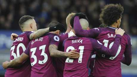 Manchester City players celebrate after Manchester City's Raheem Sterling goal