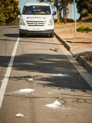 Rocks and a garden stake that witnesses said were used by a gang of youths to brutally beat a motorist in Morphett Vale overnight. Picture: Matt Loxton/AAP