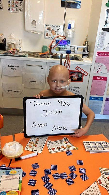 HEARTFELT THANKS: Albie Batty is grateful to Julian Wilson for his donated prize pack towards the online auction.