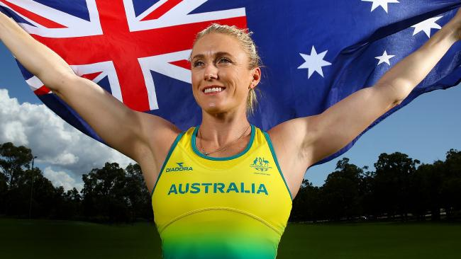 Australian athlete Sally Pearson poses with the Australian flag ahead of the 2018 Commonwealth Games on the Gold Coast. Picture: Adam Head