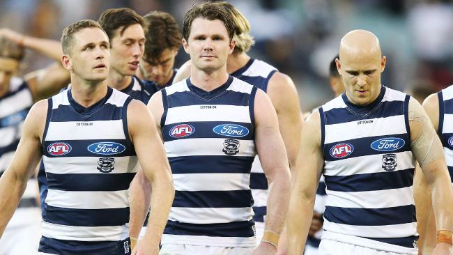 Joel Selwood, Patrick Dangerfield and Gary Ablett after the loss.