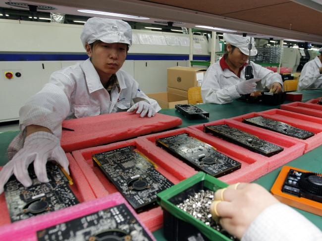 While your iPhone was probably assembled in China, most of the parts weren't made there. Picture: Kin Cheung / AP