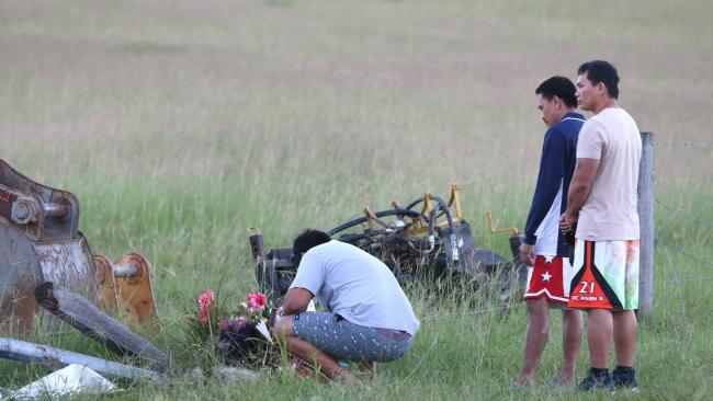Friends of Jayson Omambac visit the scene of the fatal crash. Picture: AAP Image/Steve Pohlner