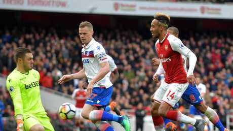 Stoke City's English goalkeeper Jack Butland (L) stops a shot from Arsenal's Gabonese striker Pierre-Emerick Aubameyang