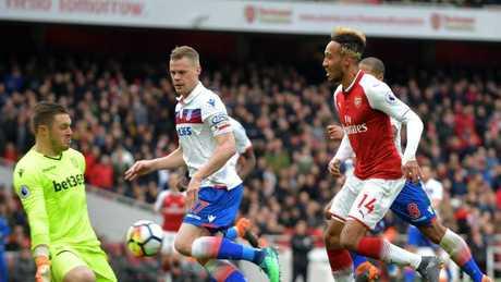 Stoke City's English goalkeeper Jack Butland (L) stops a shot from Arsenal's Gabonese striker Pierre-Emerick Aubameyang