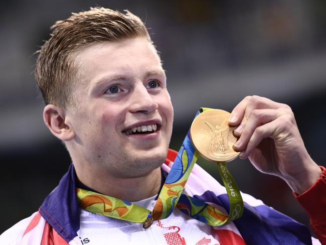 Adam Peaty shows off his gold after breaking the world record in Rio. Picture: AFP