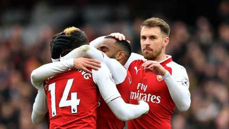 Arsenal's French striker Alexandre Lacazette (C) celebrates scoring the team's third goal during the English Premier League football match between Arsenal and Stoke City