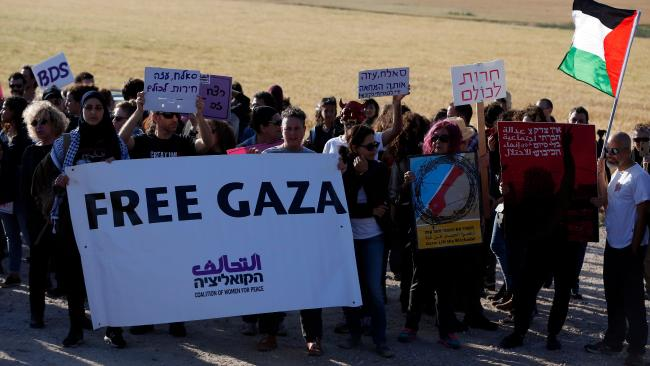 Palestinian and Israeli activists from the Coalition of Women for Peace take part in a demonstration on March 31, 2018, along the Gaza border. Picture: AFP/Ahmad Gharabli