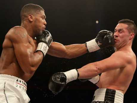 Anthony Joshua connects with New Zealand's Joseph Parker in their world title bout on March 31. Picture: Richard Heathcote/Getty Images