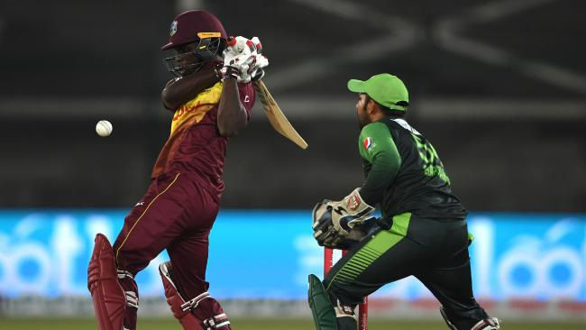 Chadwick Walton plays a shot as Pakistani wicketkeeper Sarfraz Ahmed looks on.  Picture: Asif Hassan/AFP