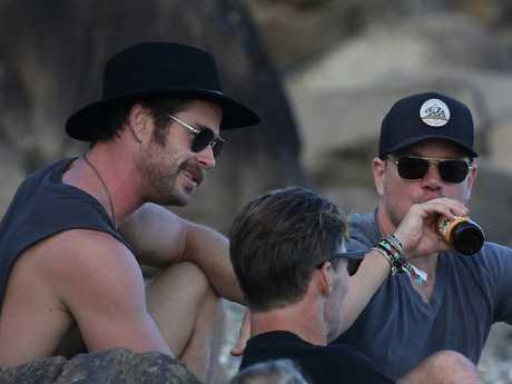 Matt Damon joined the Hemsworth family for a beer on the beach. Picture: KHAPGG / MEGA