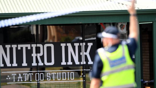 Police officers monitor the scene of a shooting at a tattoo parlour in Melbourne's Hampton Park in February. Picture: Joe Castro/AAP