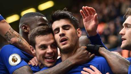 Chelsea's Spanish striker Alvaro Morata (C) celebrates with teammates after scoring the opening goal