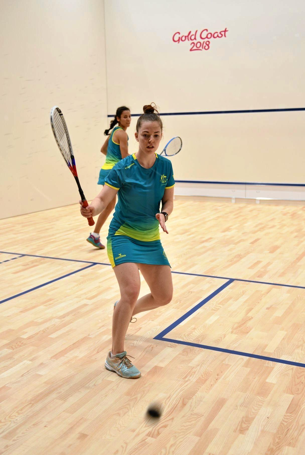 BUSY TIME: Coffs Harbour squash player Tamika Saxby practicing with an Australian teammate on the Gold Coast ahead of the Commonwealth Games.