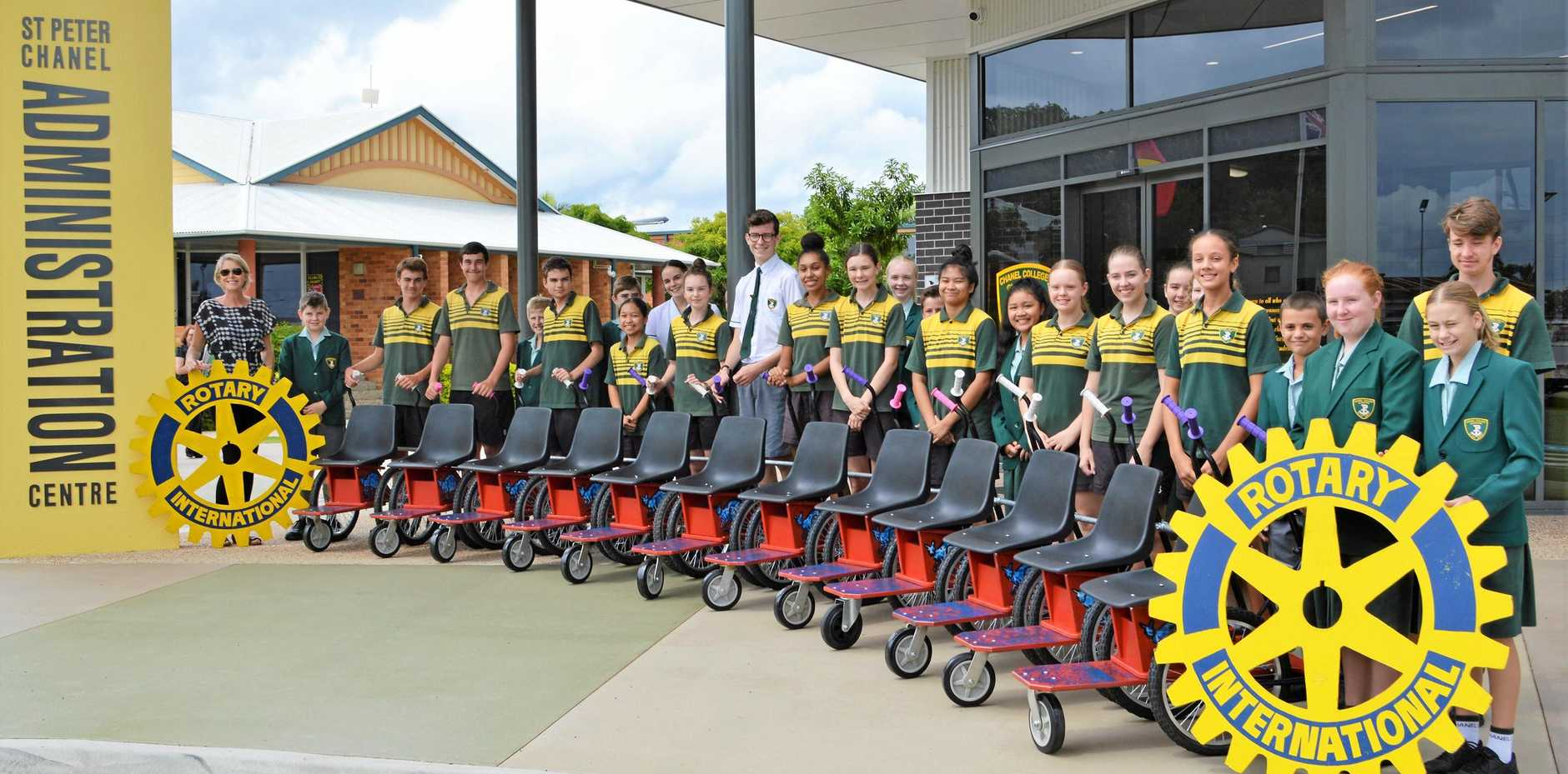 HELPING HAND: Chanel College students proudly display the wheelchairs they painted