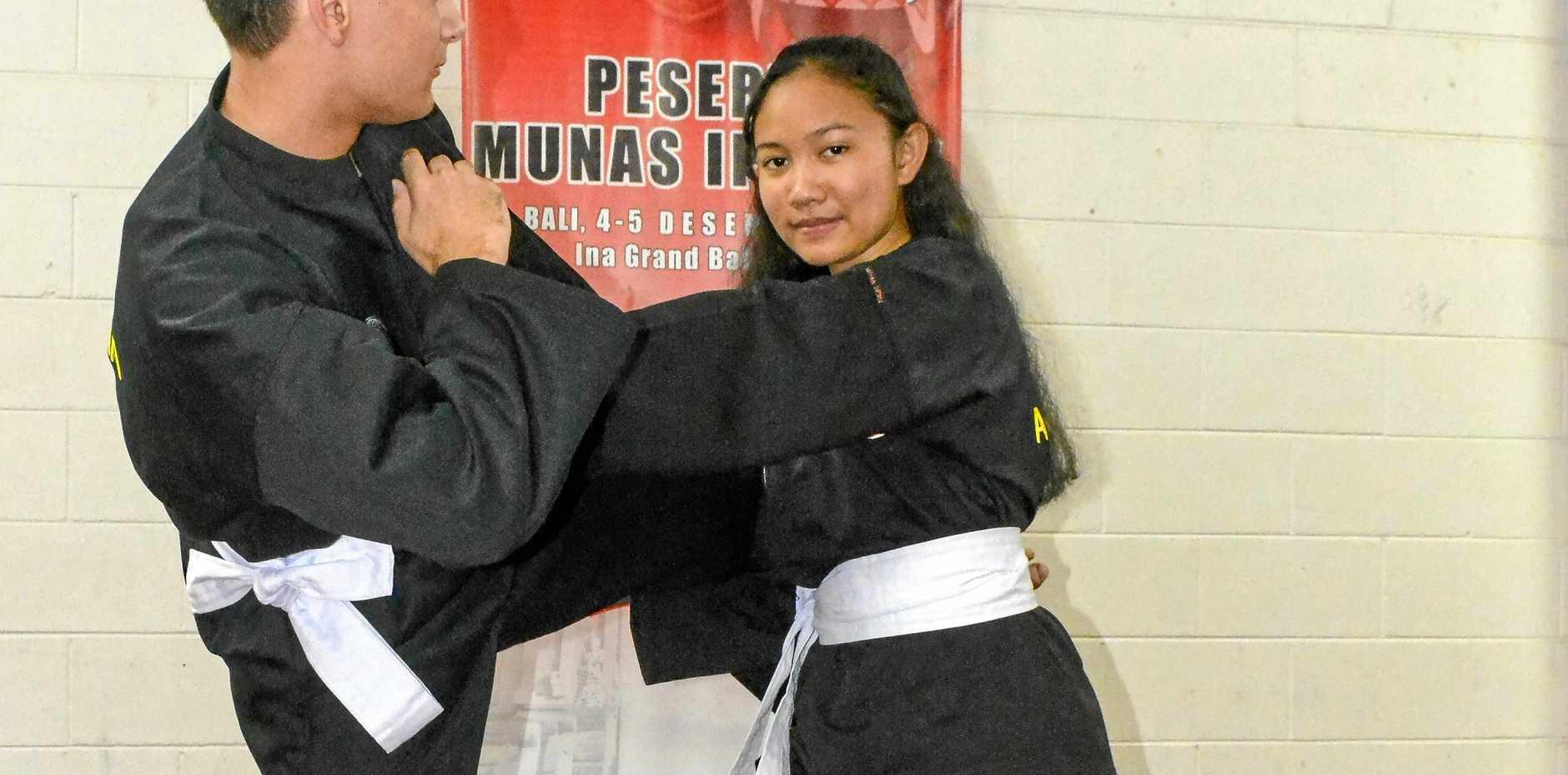 ALIVE AND KICKING: Martial Arts Silat Baru Australian representatives Latu Biran-Mailangi practices on Viona Madea.