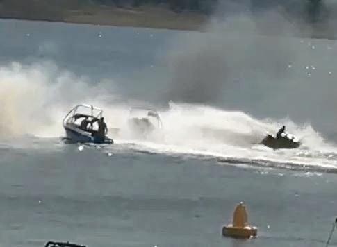 Coast man Jason Dobinson used his jetski to prevent a boat on fire from exploding.