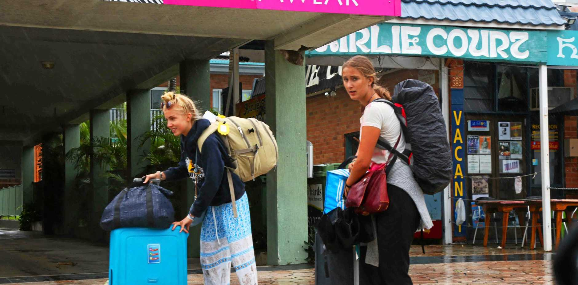 Travellers in Airlie Beach in the process of leaving town.