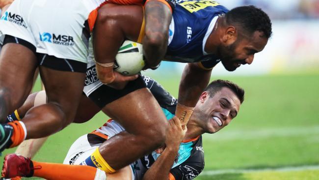 Luke Brooks makes a tackle on Tony Williams.
