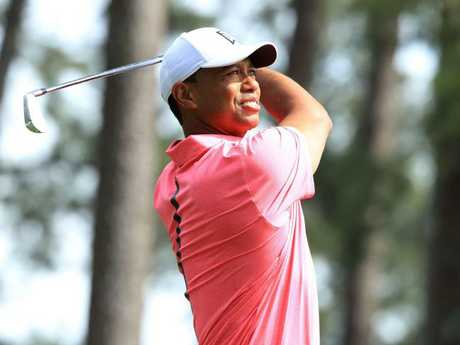 Tiger Woods plays his shot from the fourth tee during a practice round.