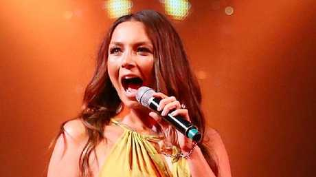 Ricki-Lee Coulter will perform from a deck chair in the sand in the middle of the stadium. Picture: Getty