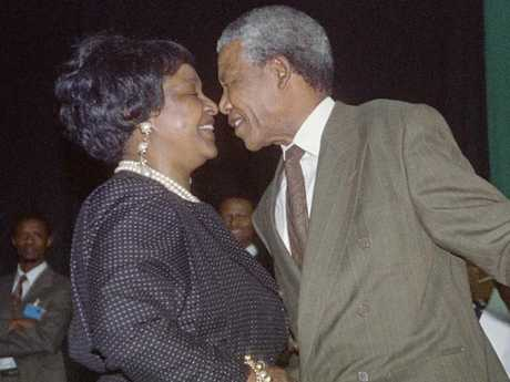 Nelson Mandela kisses his then-wife Winnie Mandela in 1991 after being unanimously elected to succeed to African National Congress. Picture: AFP PHOTO / TREVOR SAMSON