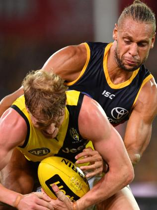 Cam Ellis-Yolmen of the Crows tackles Josh Caddy of the Tigers at Adelaide Oval on Thursday night. Picture: AAP Image/David Mariuz