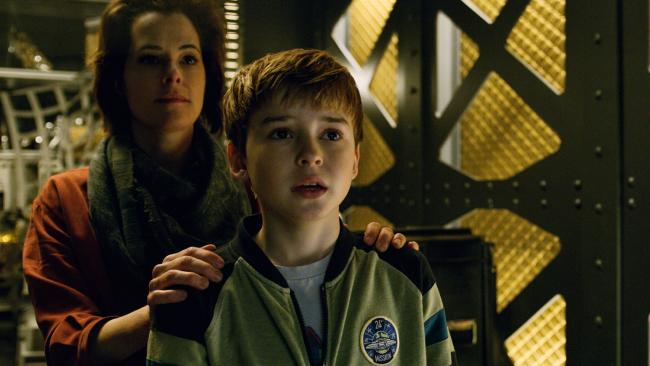 Parker Posey as Dr Smith and Maxwell Jenkins as Will Robinson in Netflix reboot of Lost In Space. Picture: Supplied/Netflix